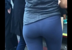 girl waiting the bus sweating thong after gym