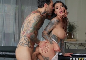 Bosomed brunette with tattoos gets roughly fucked by kinky masseur